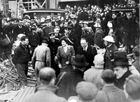King George VI & Queen Elizabeth visiting Freemasons Road after an air raid. 23 April 1941.