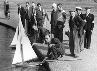 West Ham Mayor Percy Hearn prepares to set sail at a Forest Gate Model Yacht Club competition. c1949.
