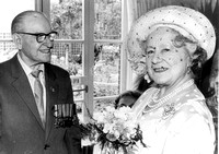 The Queen Mother with Mr M F Outten during a visit to Stondon House, Guinness Trust, Plaistow Road. 28 June 1984.